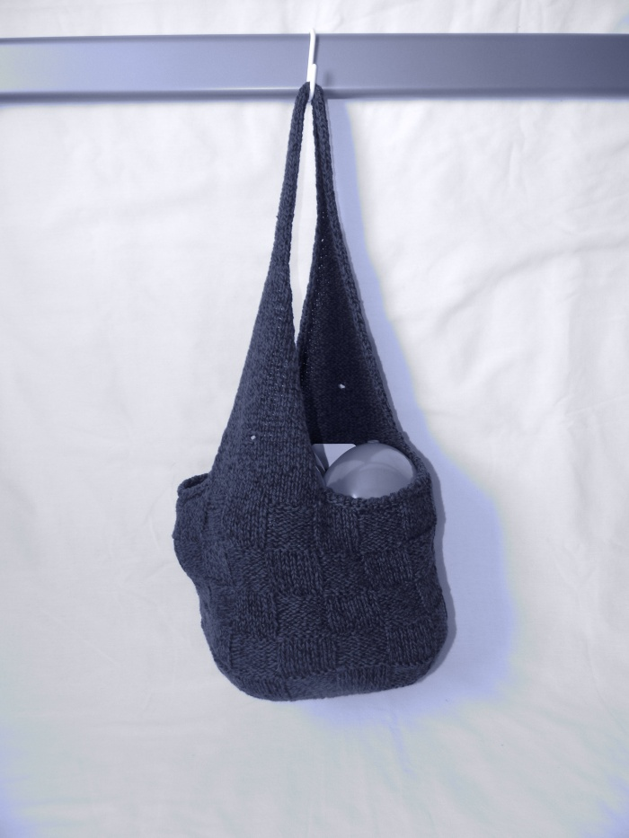 Hobo bag with basket-weave pattern.